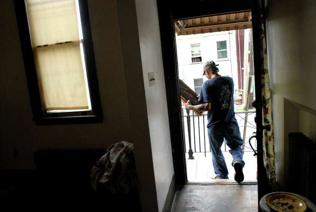 "Samuel ""Poppy"" Baez moves his belongings from an apartment on Tuesday, Sept. 8, 2009, on Delaware Street in Albany, N.Y. (Cindy Schultz / Times Union) Photo: CINDY SCHULTZ"