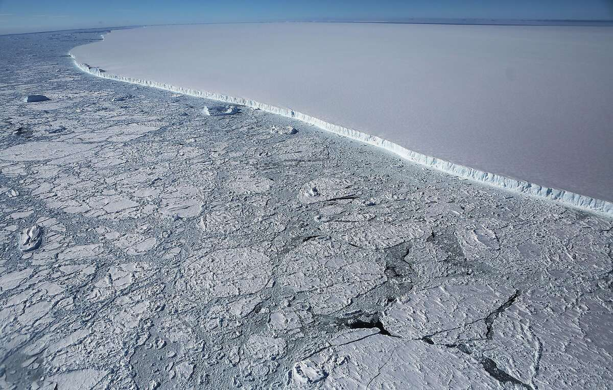 The western edge of the famed iceberg A-68 (TOP R), calved from the Larsen C ice shelf, is seen from NASA's Operation IceBridge research aircraft, near the coast of the Antarctic Peninsula region, on October 31, 2017, above Antarctica. The massive iceberg was measured at approximately the size of Delaware when it first calved in July. NASA's Operation IceBridge has been studying how polar ice has evolved over the past nine years and is currently flying a set of nine-hour research flights over West Antarctica to monitor ice loss aboard a retrofitted 1966 Lockheed P-3 aircraft. According to NASA, the current mission targets 'sea ice in the Bellingshausen and Weddell seas and glaciers in the Antarctic Peninsula and along the English and Bryan Coasts.' Researchers have used the IceBridge data to observe that the West Antarctic Ice Sheet may be in a state of irreversible decline directly contributing to rising sea levels. The National Climate Assessment, a study produced every 4 years by scientists from 13 federal agencies of the U.S. government, released a stark report November 2 stating that global temperature rise over the past 115 years has been primarily caused by 'human activities, especially emissions of greenhouse gases'. (Photo by Mario Tama/Getty Images)