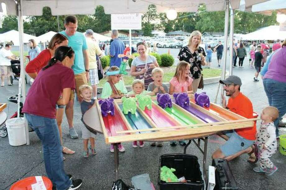 St. Mary's Catholic Church prepares for its annual Fall Fest, scheduled Sept. 7 and 8. The family-friendly event offers a variety of games and activities for children, and food, drink and live music for adults. Photo: For The Telegraph