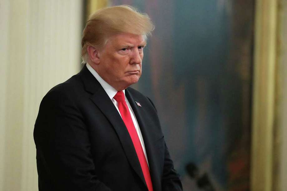 WASHINGTON, DC - AUGUST 22:  President Donald Trump listens to the opening prayer during Air Force Technical Sergeant John Chapman's Medal of Honor ceremony at the White House  August 22, 2018 in Washington, DC. Chapman was killed March 4, 2002 during a battle in Afghanistan. After his helicopter came under heavy fire and crashed, Chapman and other team members returned to the snow-capped mountain to rescue a stranded service member.  (Photo by Chip Somodevilla/Getty Images) Photo: Chip Somodevilla / 2018 Getty Images