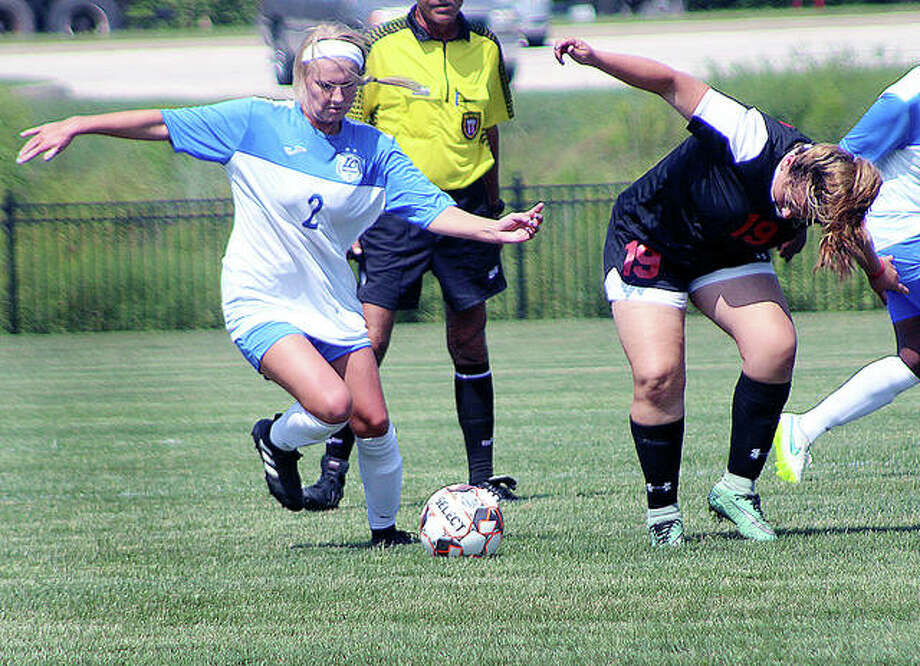 Taylor Hansen of LCCC (2) moves the ball past Southeastern Iowa's Maria Rojas Munoz (19) during the second half of Wednesday's season opener at Tim Rooney Field. The Trailblazers won 9-0. Photo: Pete Hayes | The Telegraph