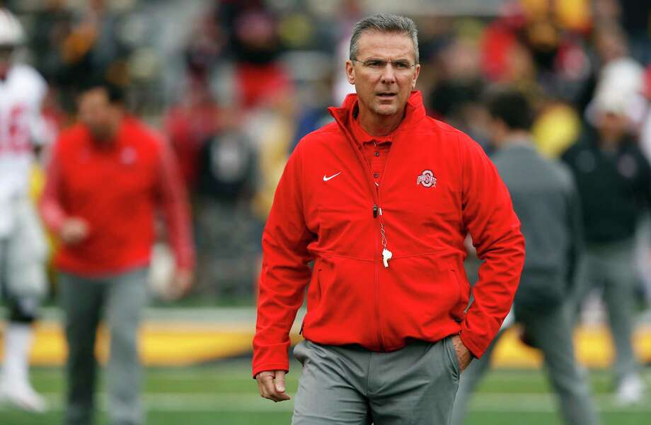 FILE - In this Nov. 4, 2017, file photo, Ohio State coach Urban Meyer walks on the field before the team's NCAA college football game against Iowa in Iowa City, Iowa. Ohio State trustees are set to discuss the future of football coach Urban Meyer. The 20-member board plans to meet in private on Wednesday morning, Aug. 22, 2018, in Columbus to decide whether Meyer should be punished for his handling of domestic-abuse allegations against a former assistant coach. (AP Photo/Charlie Neibergall, File) Photo: Charlie Neibergall / Copyright 2017 The Associated Press. All rights reserved.