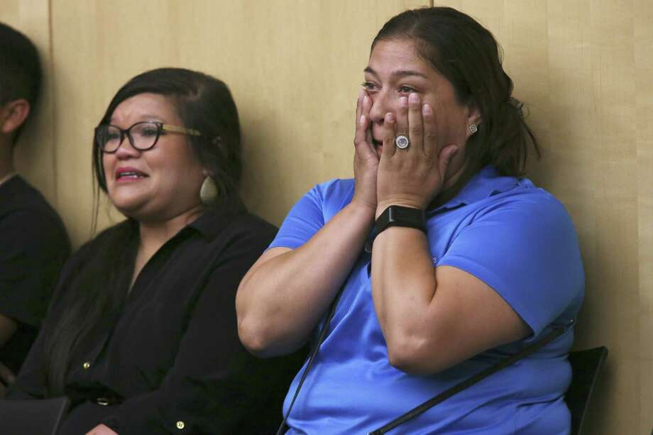 Communities in Schools site coordinators, Melissa Brown, left, and Natasha Bocanegra, react after the South San Independent School District amends its 2018-2019 budget to keep the program during a Special Called Meeting Aug. 22. Three new members will join the board of this troubled district. They must work to continue progress. Photo: JERRY LARA /San Antonio Express-News / © 2018 San Antonio Express-News