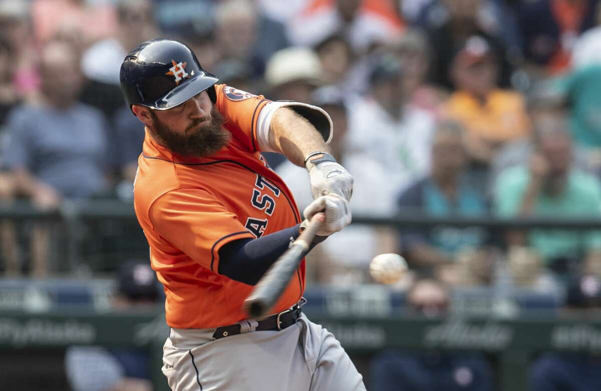 SEATTLE, WA - AUGUST 22: Tyler White #13 of the Houston Astros hits a solo home run off of relief pitcher Adam Warren #43 of the Seattle Mariners during the eighth inning of a game at Safeco Field on August 22, 2018 in Seattle, Washington. The Astros won the game 10-7. (Photo by Stephen Brashear/Getty Images)
