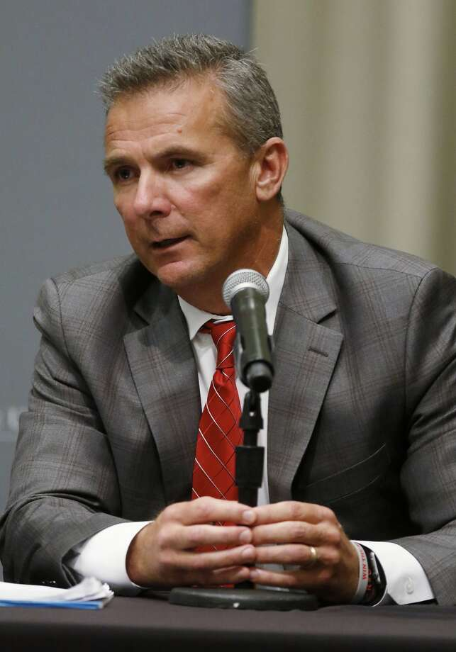 Urban Meyer mis hand led abuse allegations against an assistant. Photo: Paul Vernon / Associated Press