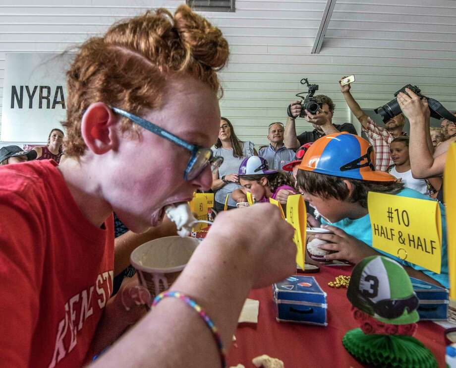 Eleven year old Lucy Holland, 11 of Katonah tried her best to down a pint of Stewart's Ice Cream during an ice cream eating contest Wednesday Aug. 22, 2018 at the Saratoga Race Course in Saratoga Springs, N.Y. She finished second by a nose.  (Skip Dickstein/Times Union) Photo: SKIP DICKSTEIN