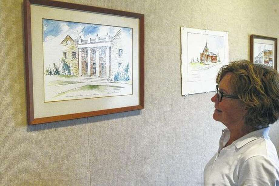 Addie Coultas of Jacksonville looks at a watercolor painted by the late Homer Bradney, a longtime Jacksonville resident who died in 1980. This watercolor and 10 other artworks by Bradney will be auctioned Saturday during The Art Association of Jacksonville's annual lawn party at the David Strawn Art Gallery, 331 W. College Ave.