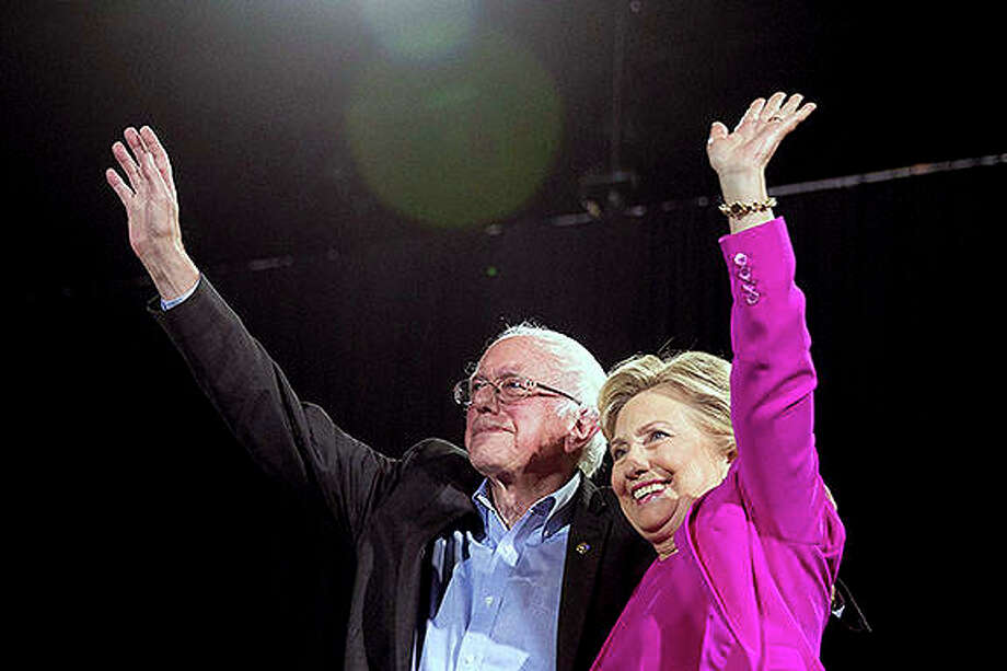 Former Democratic presidential candidates Hillary Clinton and Bernie Sanders appear on stage at a rally in 2016. Democrats are bullish about their prospects in the November midterms, and are peeking around the corner at a 2020 rematch with President Donald Trump. But first, they're confronting the lingering frustration from 2016. That bitter nominating fight between Clinton and Sanders is front and center in Chicago as members of the Democratic National Committee gather for their 2018 summer meeting. They'll decide the fate of so-called super-delegates. Photo: Andrew Harnik | AP