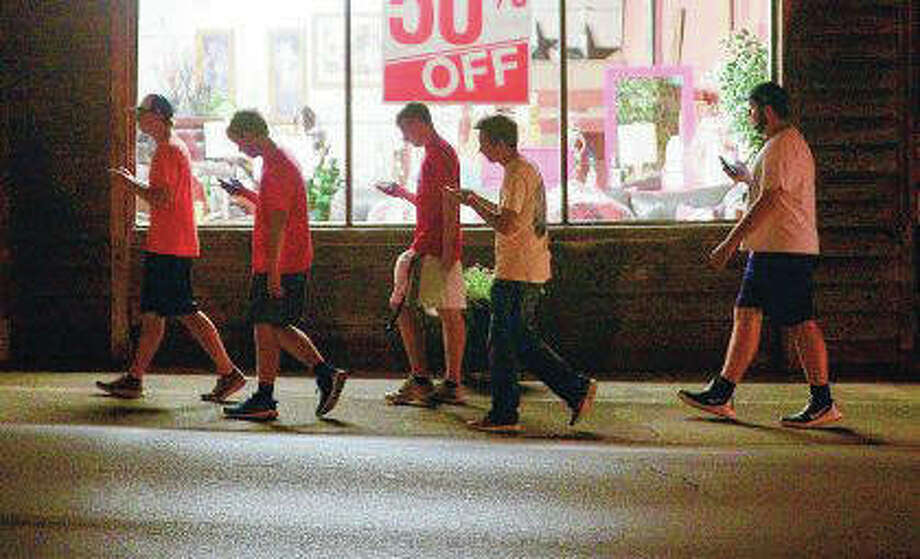 A group of teenagers play Pokemon Go. A study Wednesday from the Pew Research Center found that two-thirds of parents are concerned about the amount of time their teenage children spend in front of screens, while more than a third expressed concern about their own screen time. Photo: Crystal VanderWeit | Decatur Daily (AP)