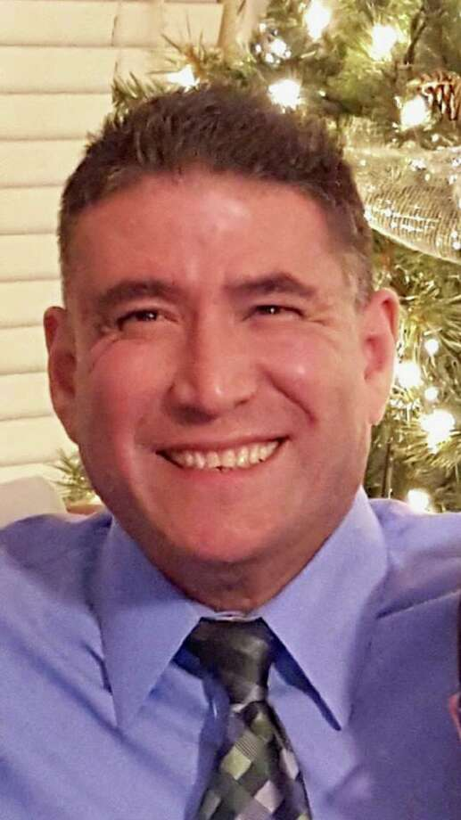 Arnoldo Dimas, 59, was a 24-year Police Department veteran who died Friday as a result of a sudden medical episode, according to authorities. Photo: Courtesy Laredo Police Department