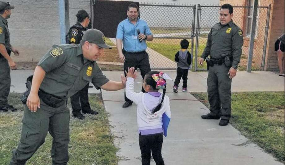 Border Patrol agents from the Laredo Sector Border Community Liaison Program welcomed students back to school at the entrances of Milton Elementary, Malakoff elementary and Farias Elementary. Photo: Courtesy Border Patrol