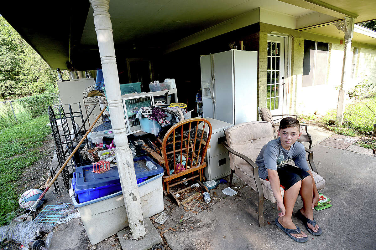 Tanner Allison, 11, as he spends an evening at home with his mother Amanda and siblings. The Allison family were flooded out of their home on Third Street in Vidor, with 6 1/2' of water filling their home. Recovery has been slow, and the family of 5 are still living in trailers set up in the back yard. Wednesday, August 22, 2018 Kim Brent/The Enterprise