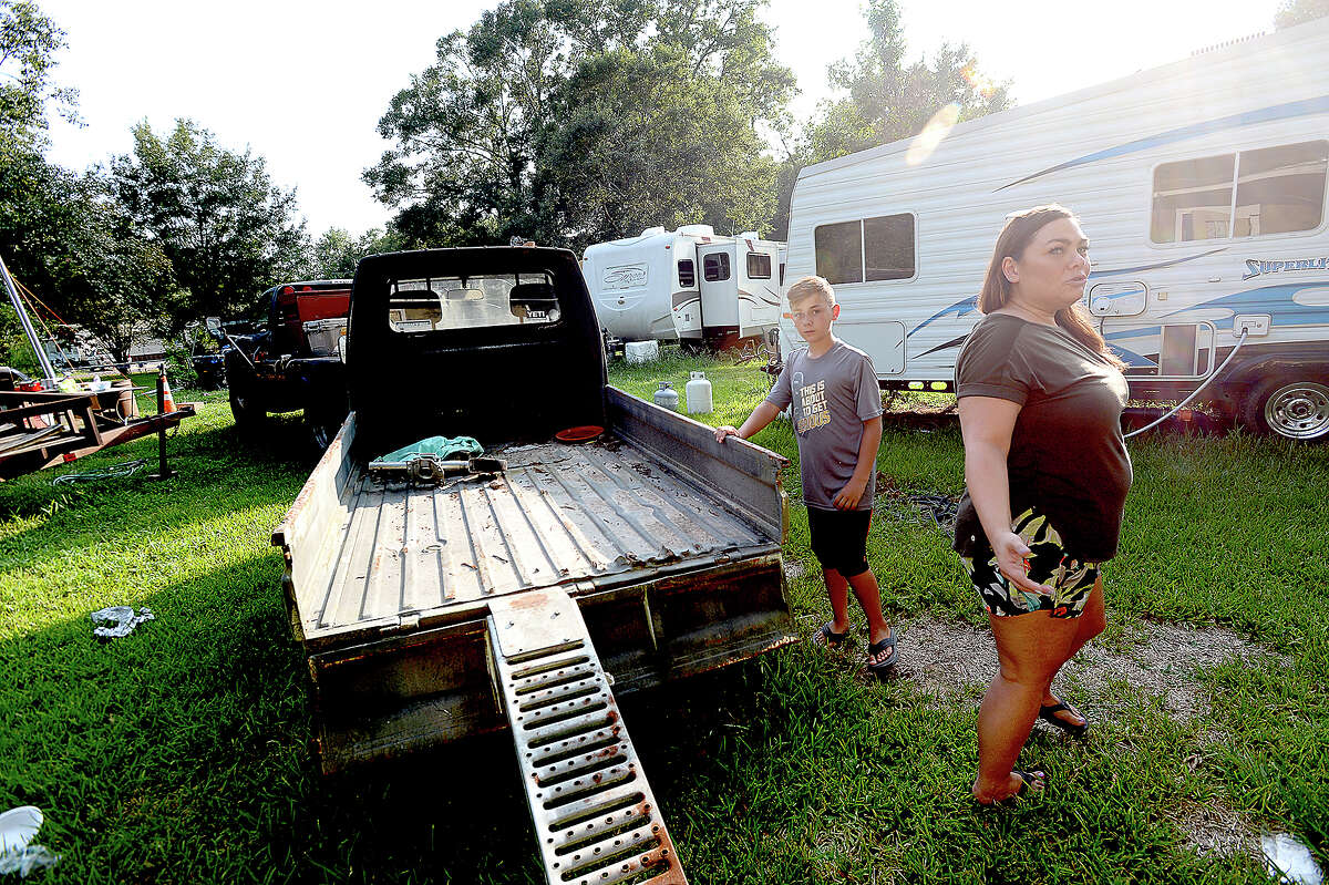 Tanner Allison, 11, looks on as is mother Amanda talks about the impact and slow recovery from flooding after Harvey inundated the area, including her neighborhood in Vidor. Wednesday, August 22, 2018 Kim Brent/The Enterprise