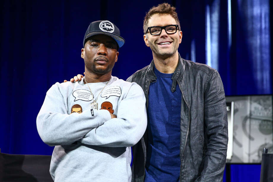 Charlamagne Tha God, co-host of The Breakfast Club, speaks with host Bobby Bones about his book 'Black Privilege: Opportunity Comes to Those Who Create It' on stage at the iHeartRadio Theater in Burbank, California on May 8, 2017. Both will soon debut on the San Antonio airwaves. Photo: Getty Images