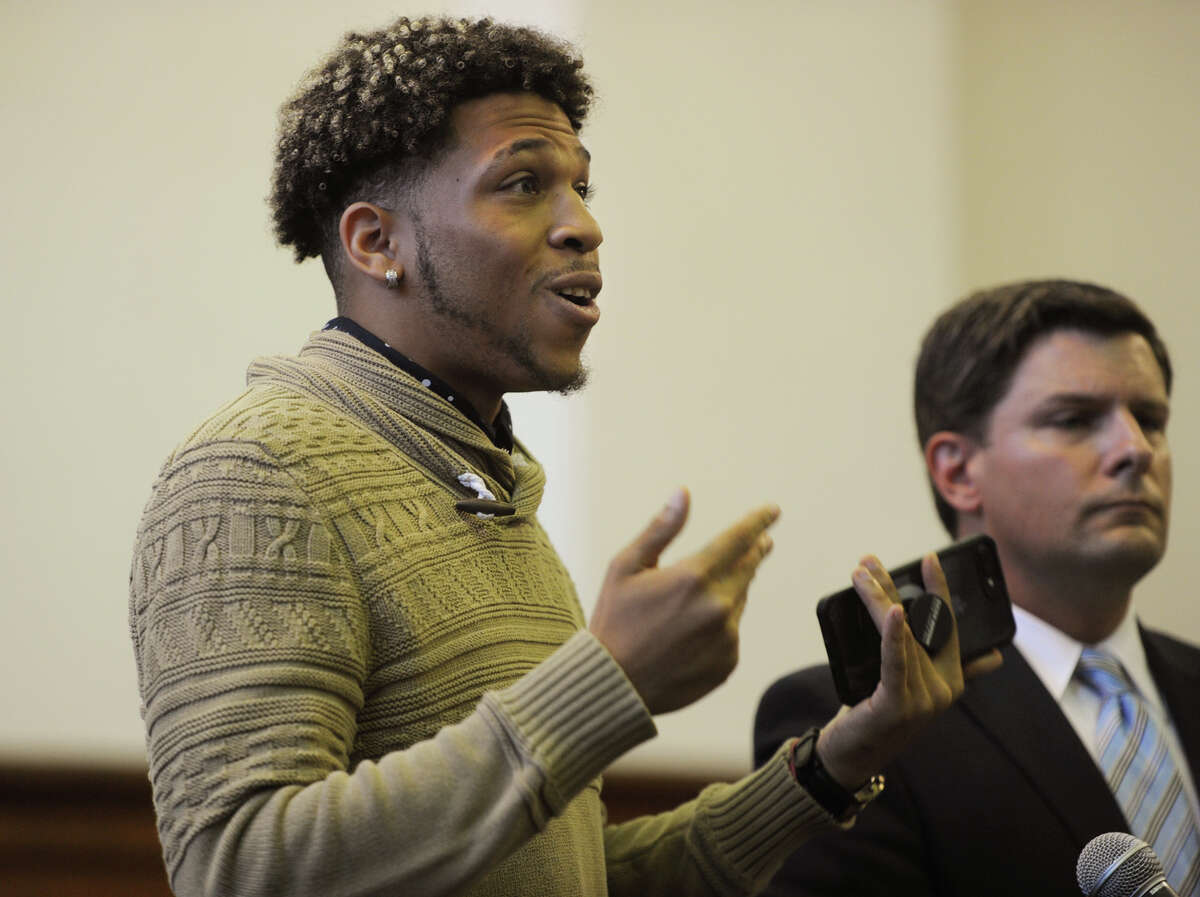 Standing beside his lawyer Frank Riccio, III, former Sacred Heart University football player Malik St. Hilaire gives a statement during the sentencing of Nikki Yovino at Superior Court in Bridgeport, Conn. on Thursday, August 23, 2018. Yovino plead guilty to making false rape accusations against two Sacred Heart University football players, including St. Hilaire. Police say Yovino made up the claims because she thought the consensual encounter would damage her relationship with another student.