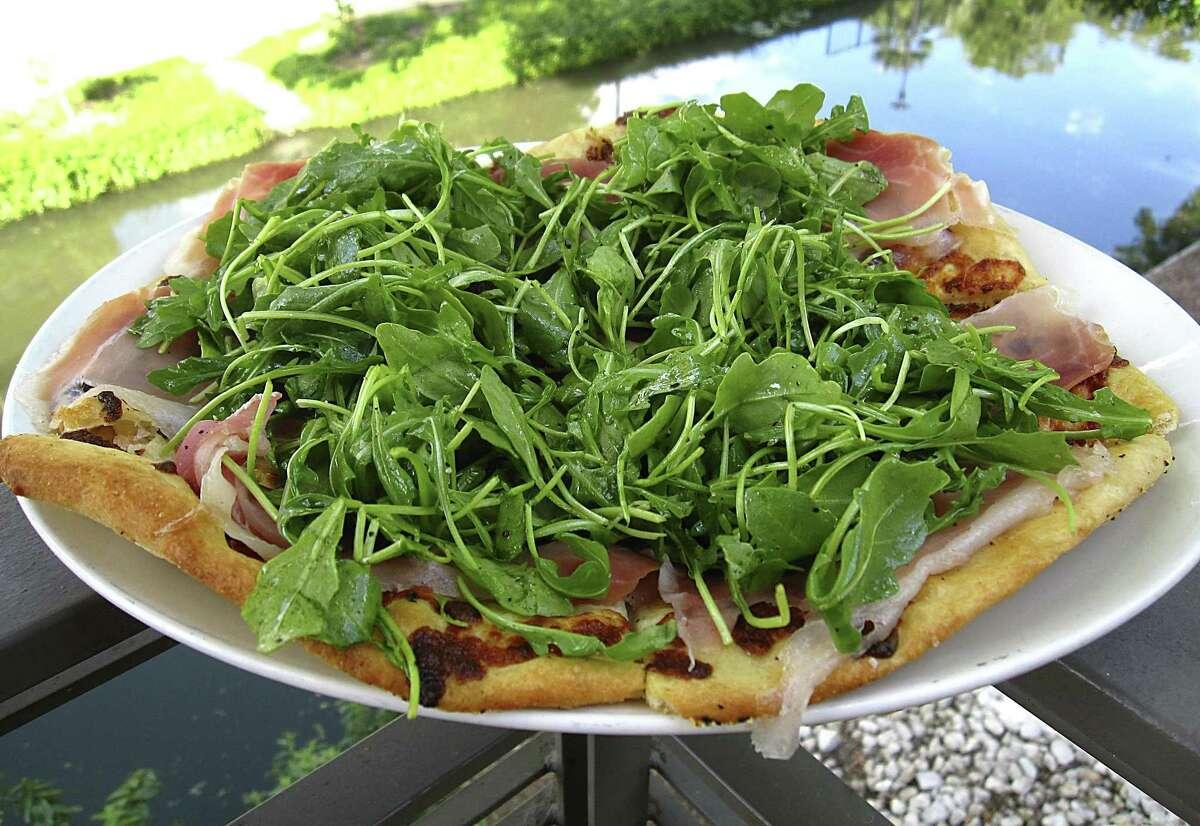 Cast-iron pizza with prosciutto, burrata cheese and arugula from Tre Trattoria.