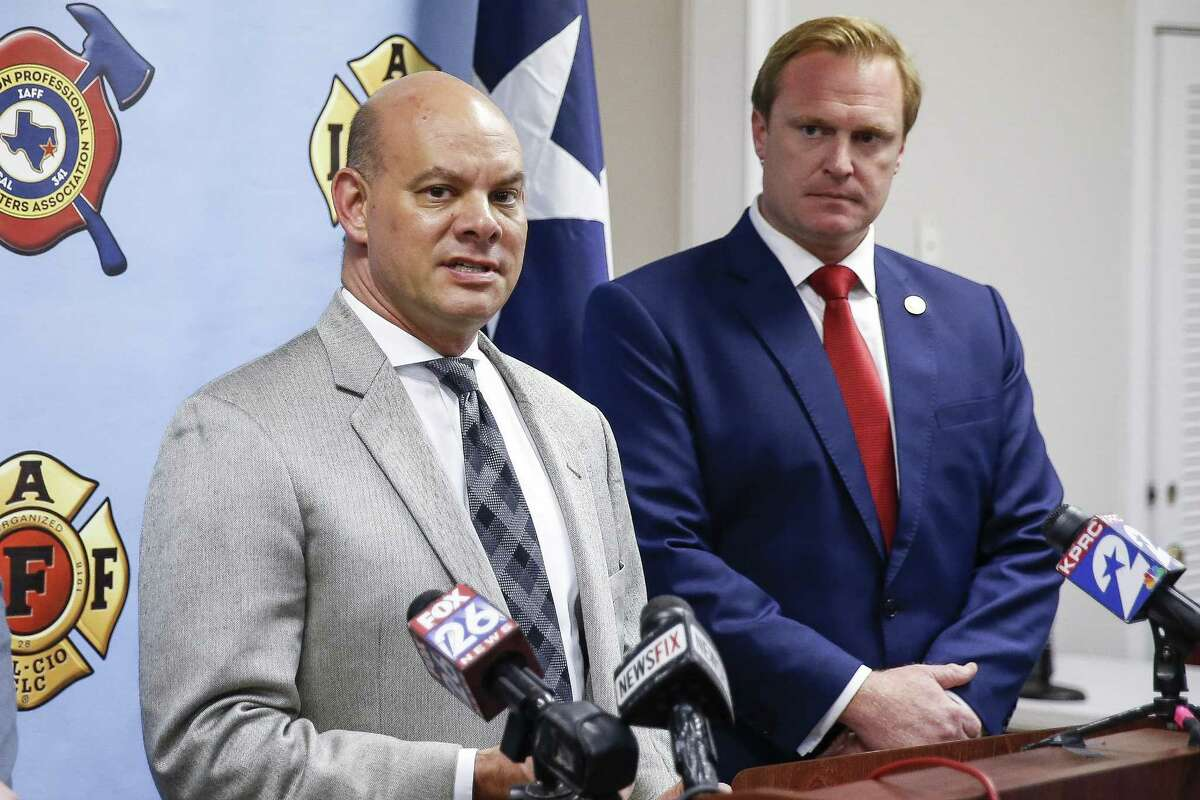 Attorney Cris Feldman, left, who is representing the Houston Professional Fire Fighters Association, speaks to the media after a judge sided with the association that Houston's City Hall improperly electioneered against firefighters?' pay measure Tuesday July 31, 2018 in Houston.