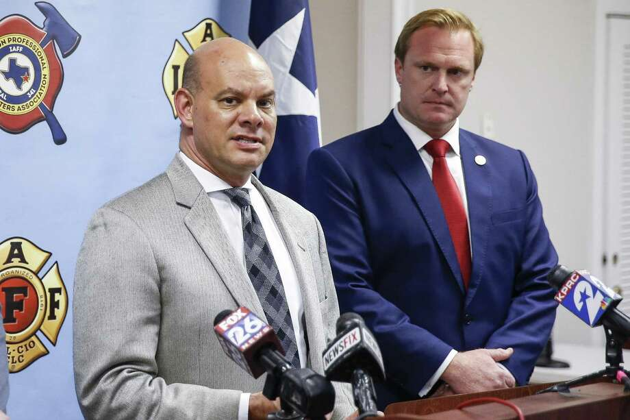 Attorney Cris Feldman, left, who is representing the Houston Professional Fire Fighters Association, speaks to the media after a judge sided with the association that Houston's City Hall improperly electioneered against firefighters' pay measure Tuesday July 31, 2018 in Houston. Photo: Michael Ciaglo, Staff Photographer / Staff Photographer / Michael Ciaglo