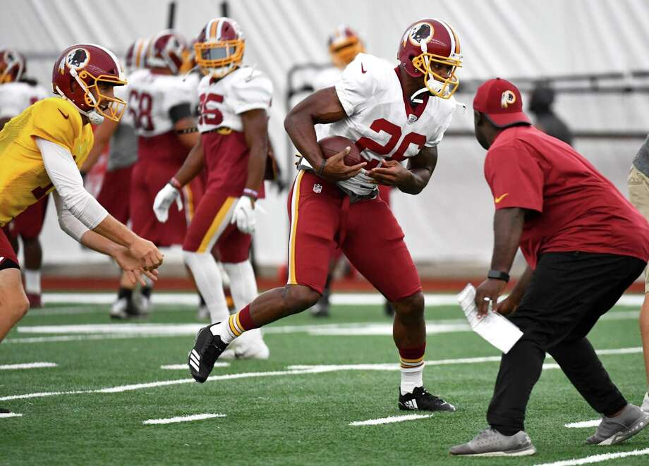 e053eb51134 Adrian Peterson takes a handoff from Alex Smith during his first practice  with the team Tuesday
