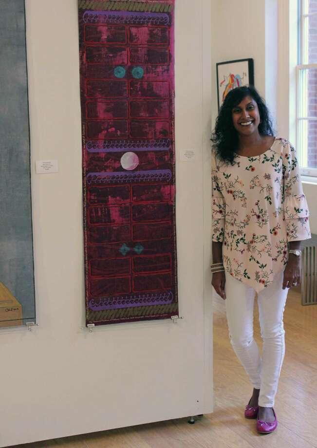 Sonal Rajan, chairman of the Board of Library Trustees, stands in the Fairfield Public Library's Kershner Gallery. Fairfield,CT. 8/23/18 Photo: Genevieve Reilly / Hearst Connecticut Media / Fairfield Citizen