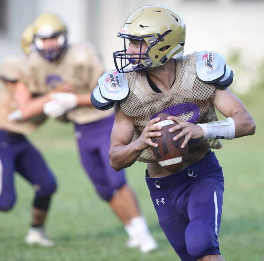 Routt's Jared Plunk rolls out to pass during a recent practice.