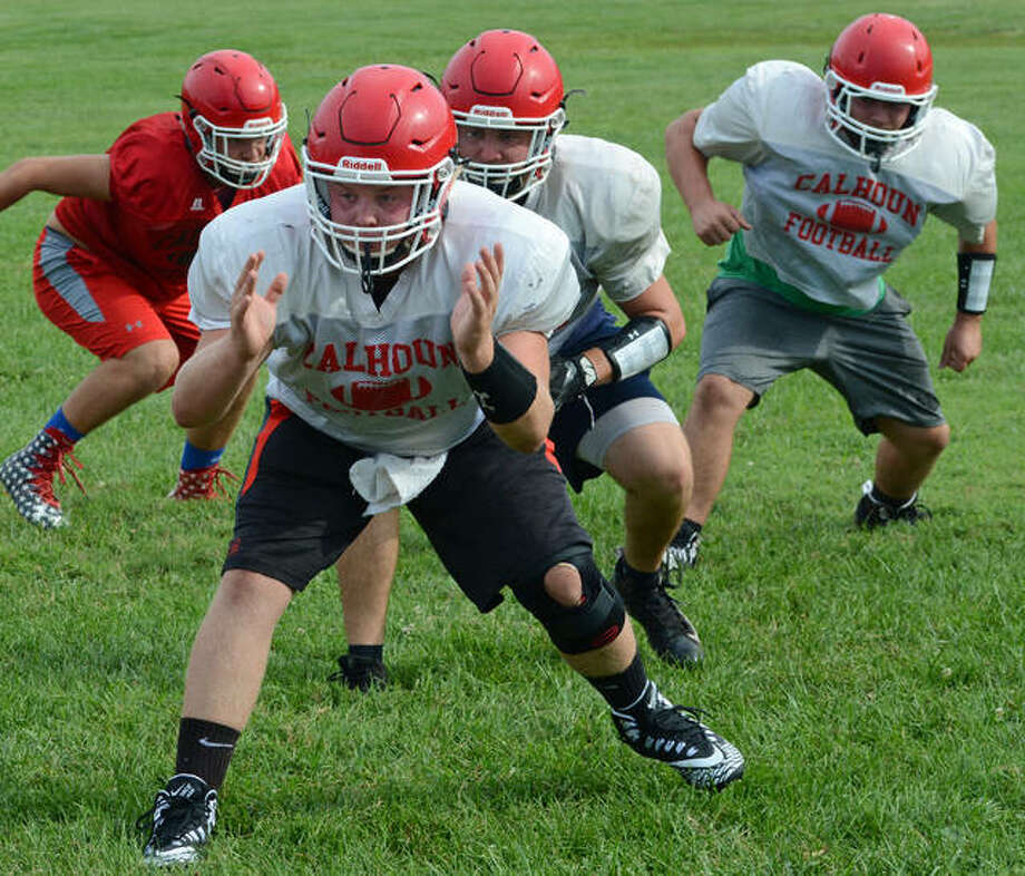 The Calhoun Warriors run through a play during a recent practice. Photo: David Blanchette | Journal-Courier