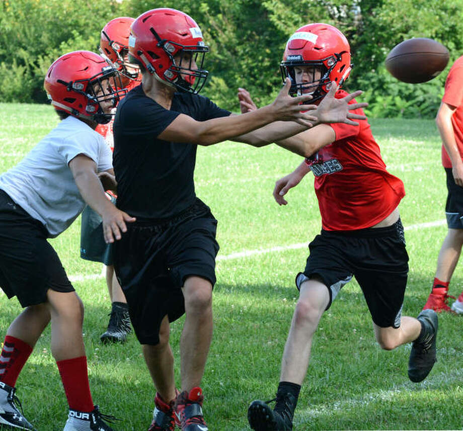 David Blanchette | Journal-Courier Members of the Pittsfield football team run a play during a recent practice.