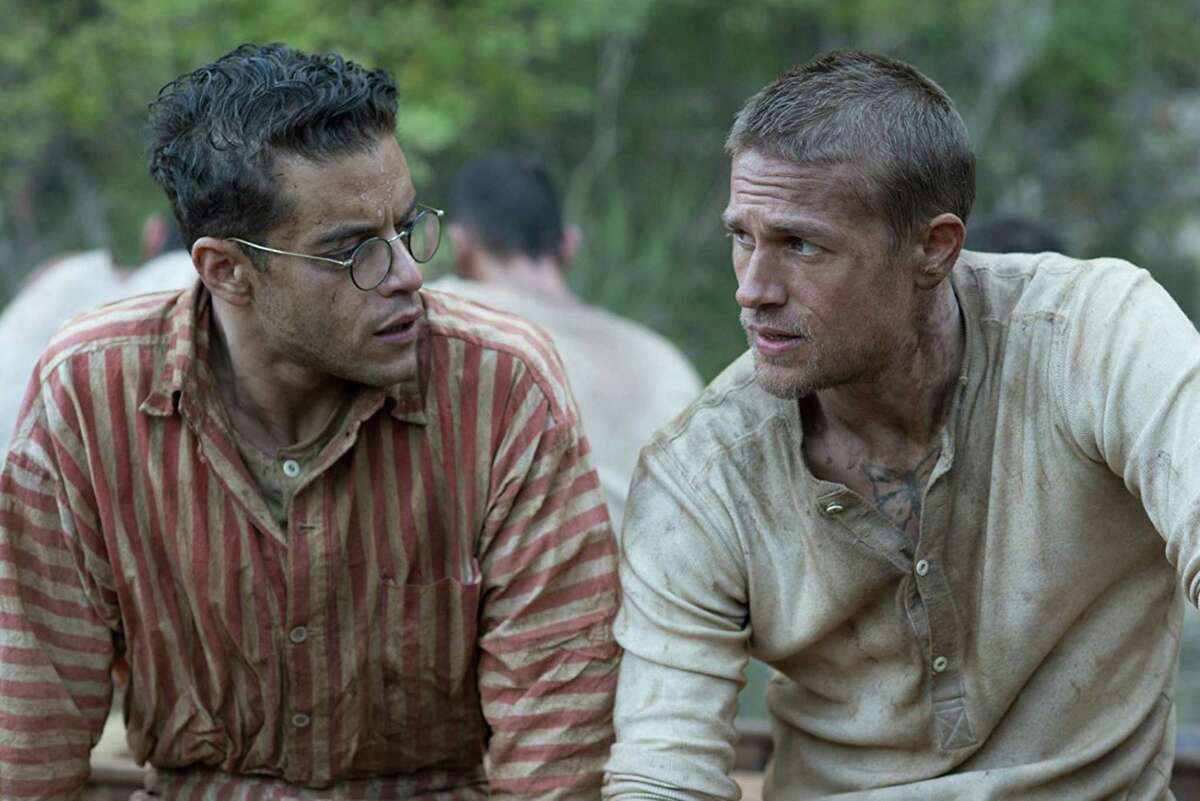 """Rami Malek plays Dega and Charlie Hunnam is Papillon, fellow prisoners in the movie """"Papillon."""""""