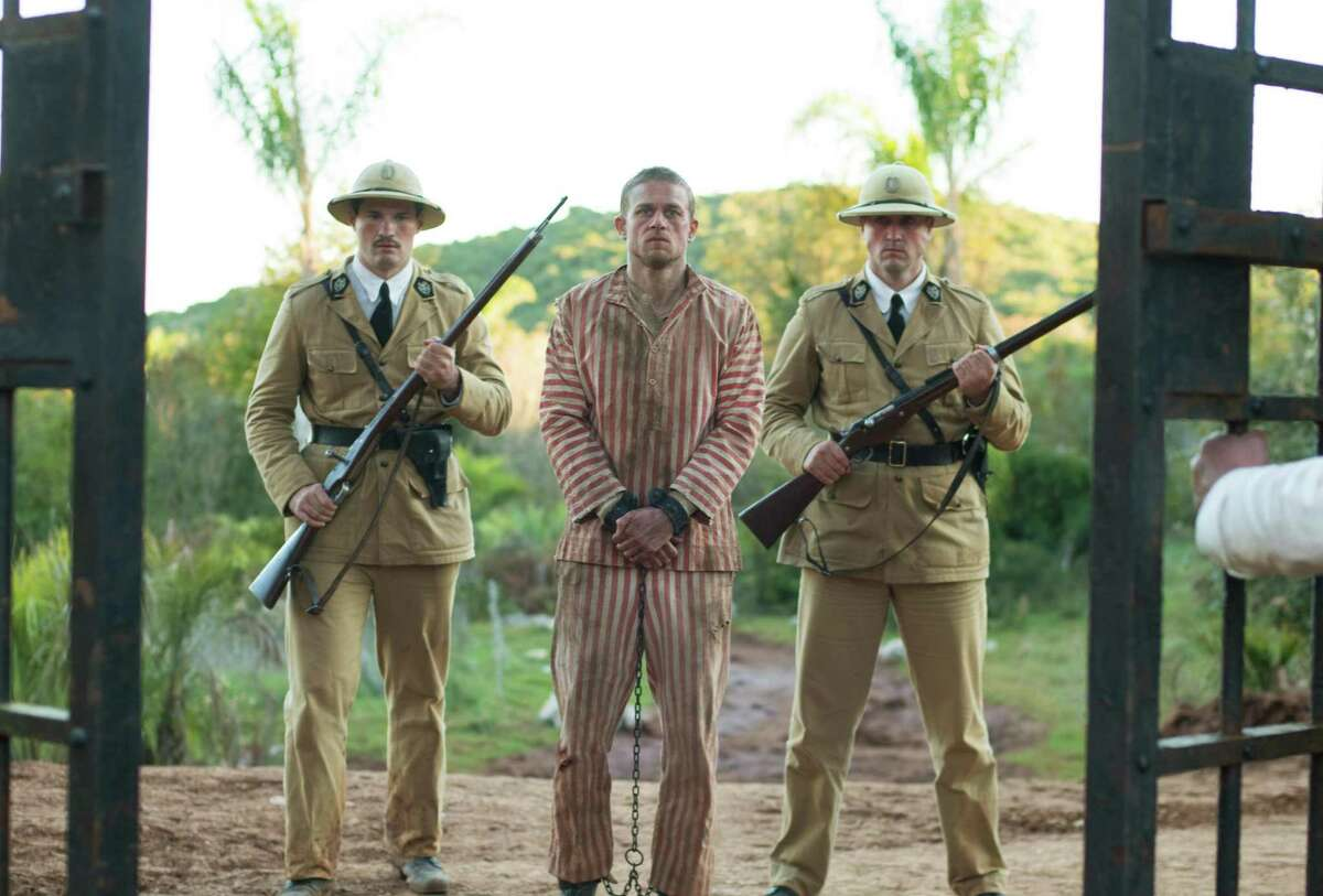 Charlie Hunnam plays Papillon, who works for a gangster in Paris but, in a gangland frame-up, is arrested for murder, convicted and sent to prison at hard labor in French Guyana.