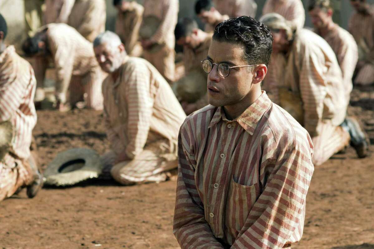 Rami Malek is Dega, a fellow prisoner, who has money to help them survive inside while Papillon provides the muscle.