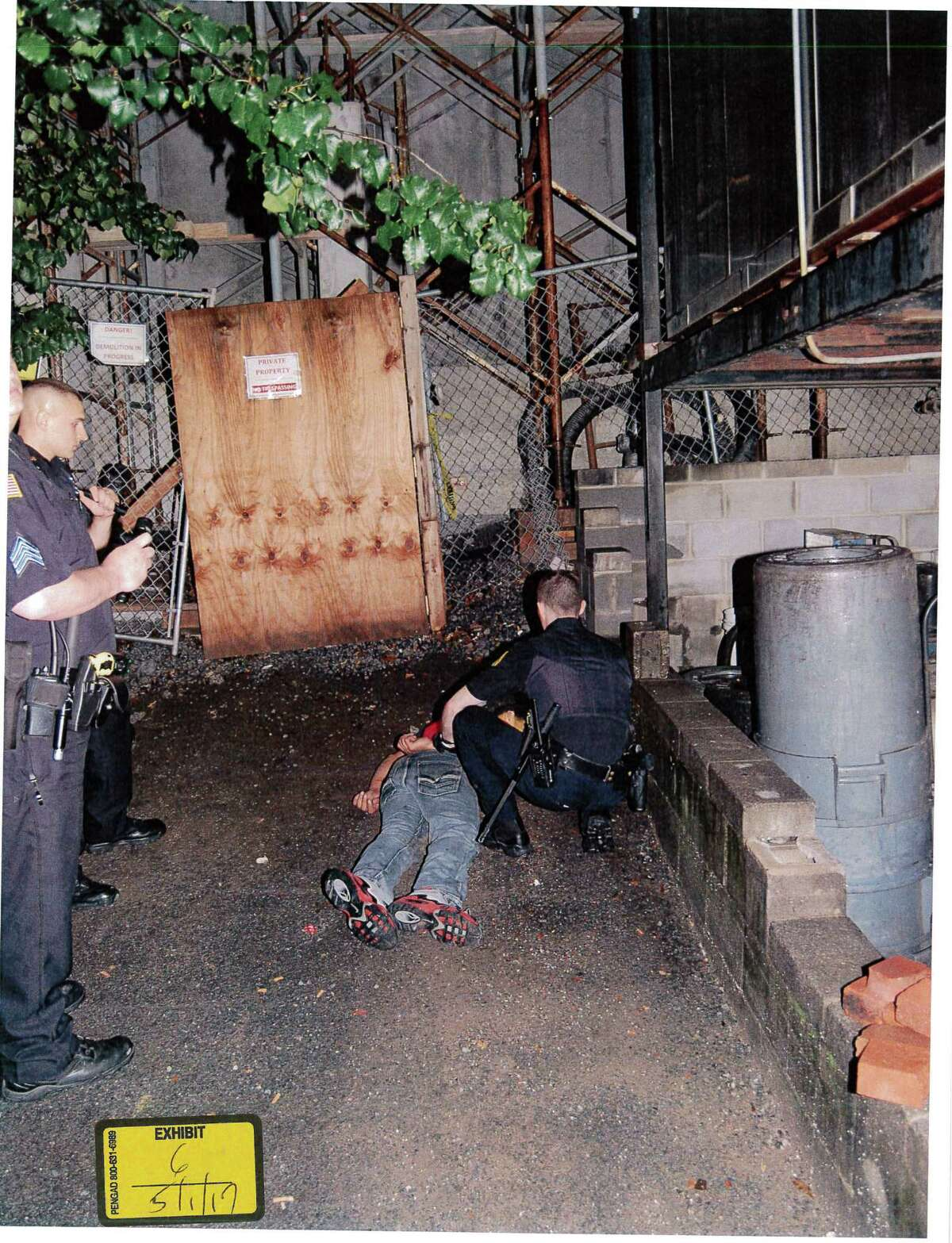 A photo from the Aug. 31, 2013 scene where Saratoga Springs police said Darryl Mount fell from scaffolding. Mount is on the ground. The photo is an exhibit in the wrongful death lawsuit brought by Mount's mother.