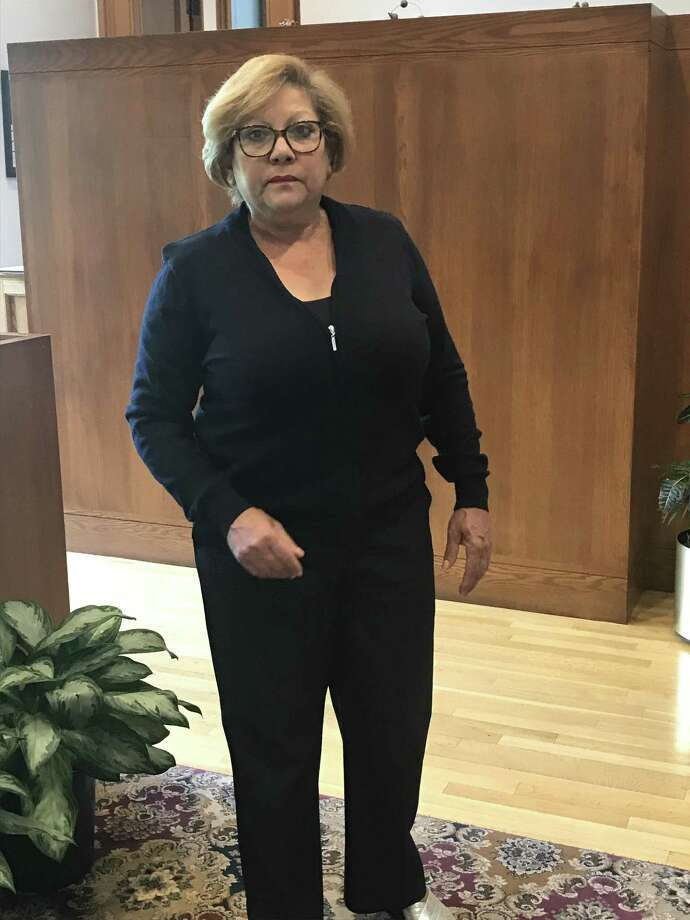 Mercedes Felix, a receptionist in the mayor's office, wearing her uniform. Photo: Jessica Lerner / Hearst Connecticut Media
