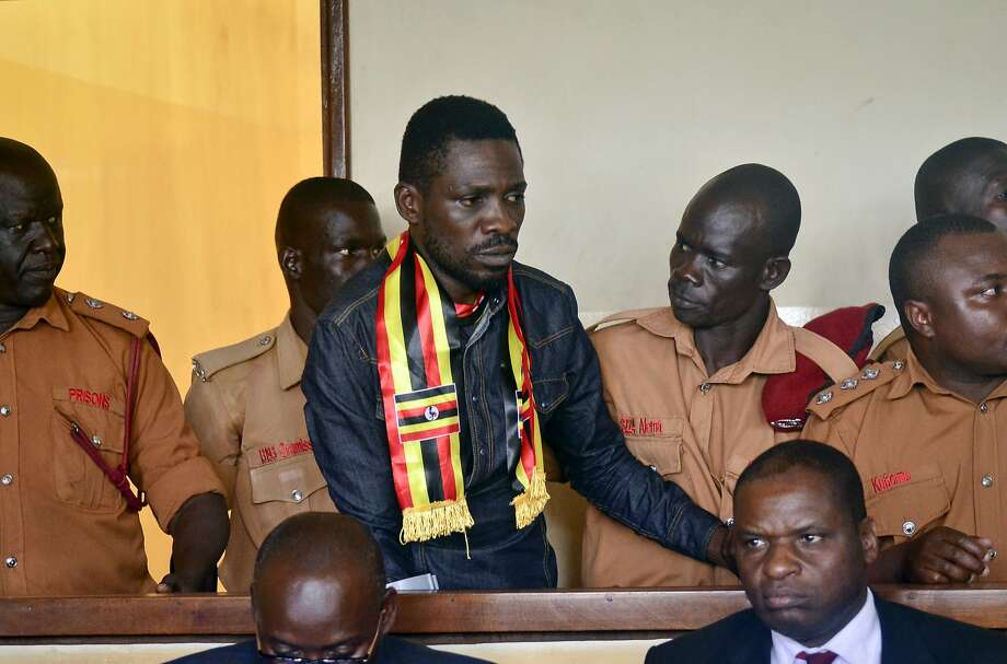 Ugandan pop star-turned-lawmaker Kyagulanyi Ssentamu, also known as Bobi Wine, center, arrives at a magistrate's court in Gulu, northern Uganda Thursday, Aug. 23, 2018. Bobi Wine, who opposes the longtime president Yoweri Museveni, was charged with treason in the civilian court in Gulu on Thursday, minutes after a military court dropped weapons charges. (AP Photo) Photo: STR, Associated Press