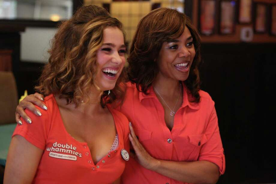 Maci (Haley Lu Richardson, left) and Lisa (Regina Hall) try to keep things together at a Hooters-like sports bar. Photo: Magnolia Pictures