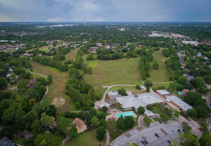 The former golf course at Inwood in north Houston has long been the planned site of a detention project, Tuesday, Aug. 7, 2018 in Houston. Currently though the former golf course sits unchanged among the neighborhood. The White Oak Conference Center anchors the property.