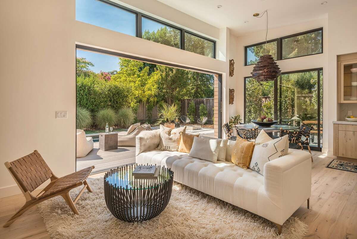 The great room opens directly to a rear deck, garden and pool patio.