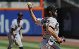 San Francisco Giants starting pitcher Madison Bumgarner delivers against the New York Mets during the first inning of a baseball game, Thursday, Aug. 23, 2018, in New York. (AP Photo/Julie Jacobson)