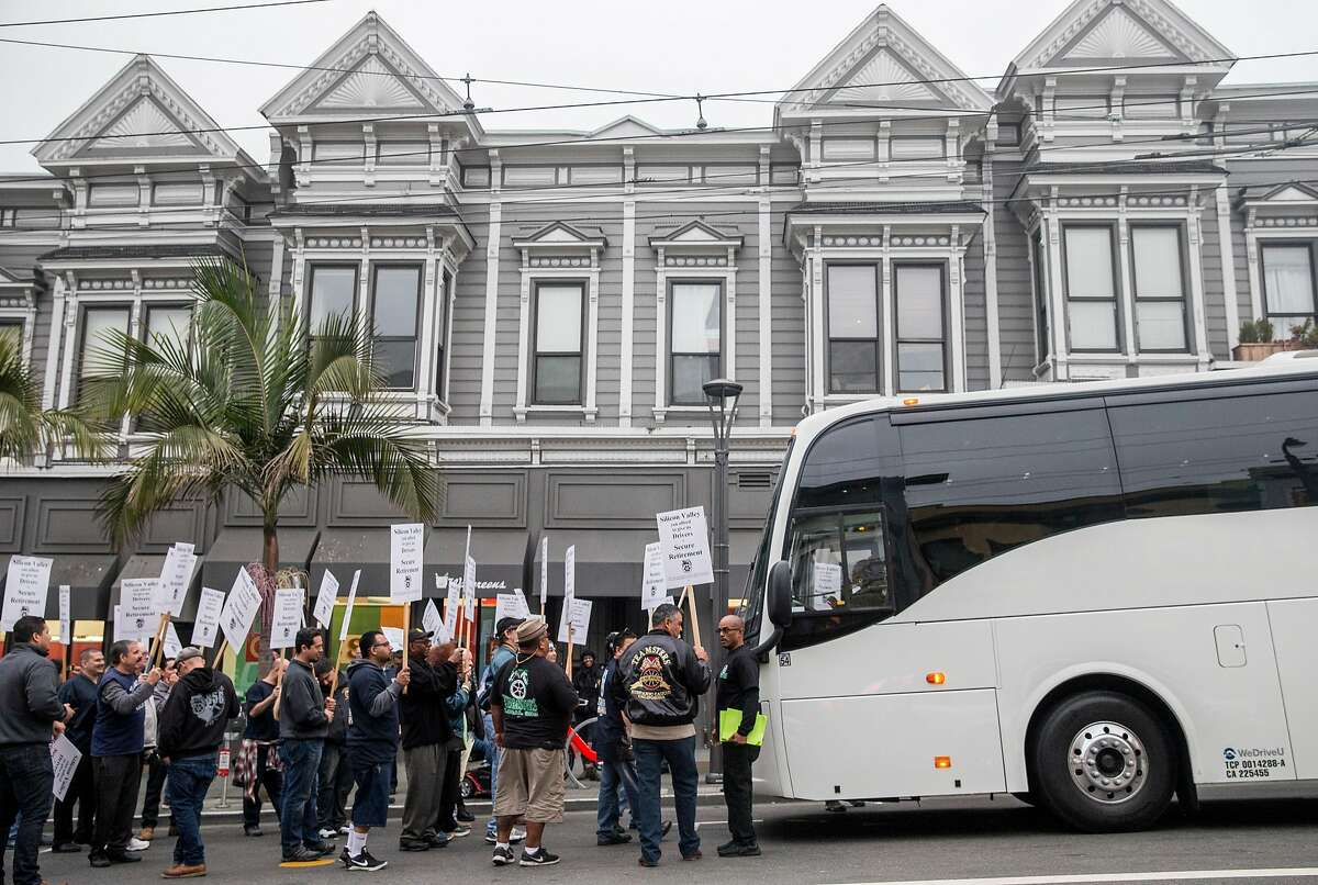Teamsters Local Union members surround and block a tech employees' bus bound for Sunnyvale at 18th and Castro streets to protest working conditions of corporate shuttle bus drivers in San Francisco, Calif. Thursday, Aug. 23, 2018