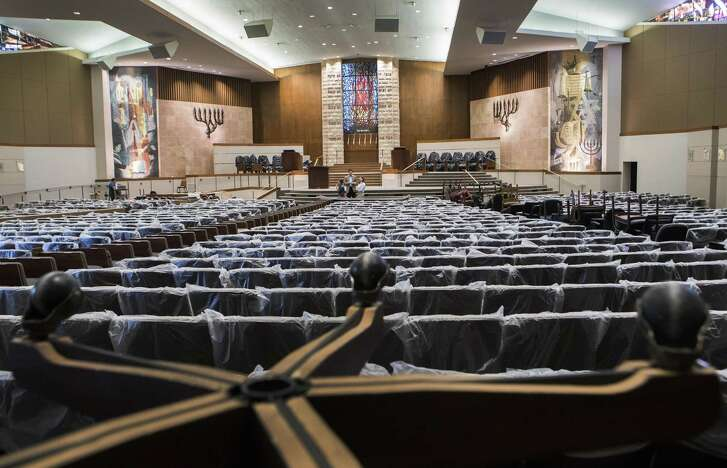 Houston's Congregation Beth Yeshurun main sanctuary called the Barg Sanctuary has been renovated with new chairs and a ramp after the space was heavily damaged by Hurricane Harvey. Tuesday, Aug. 21, 2018, in Houston.
