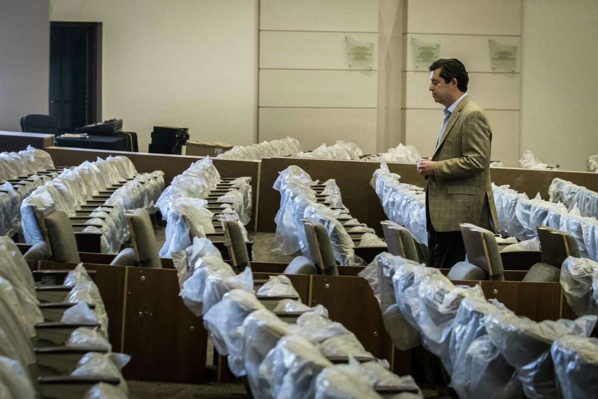 Rabbi Brian Strauss walk by the new chairs still wrapped in plastic, Tuesday, Aug. 21, 2018, in Houston. The Barg sanctuary at Beth Yeshurun was water damaged because of the flooding caused by Hurricane Harvey.