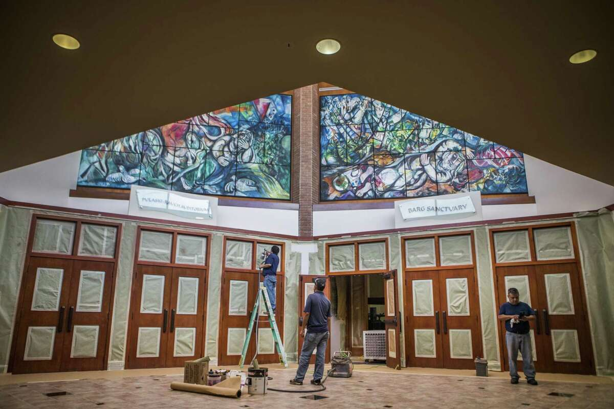 Victor Gonzalez, Juan Gonzalez and Jorge Sotelo work on the entrance doors of the Pulaski-Rauch Auditorium and the Barg Sanctuary at the Houston's Congregation Beth Yeshurun, Tuesday, Aug. 21, 2018, in Santa Fe.