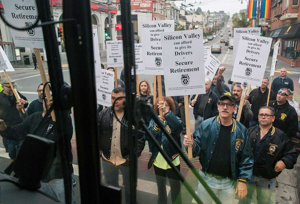 Teamsters Local Union members surround and block a tech bus bound for Sunnyvale at 18th and Castro streets to protest working conditions of corporate shuttle bus drivers in San Francisco, Calif. Thursday, Aug. 23, 2018