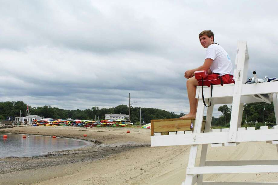 Charlie Hunter, a lifeguard, overlooking Pear Tree Point Beach. Taken Aug. 20. Photo: /Lynandro Simmons /Hearst Connecticut Media