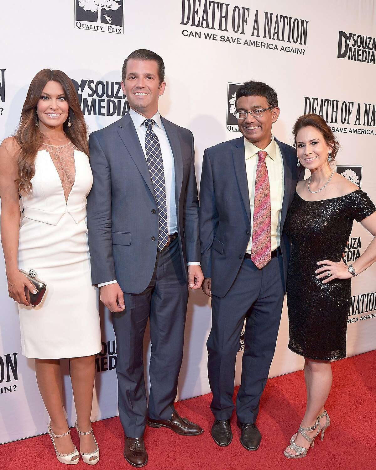 """WASHINGTON, DC - AUGUST 01: Kimberly Guilfoyle, Donald Trump Jr., Dinesh D'Souza, and Debbie Fancher attend the DC premiere of the film, """"Death of a Nation,"""" at E Street Cinema on August 1, 2018 in Washington, DC. (Photo by Shannon Finney/Getty Images)"""