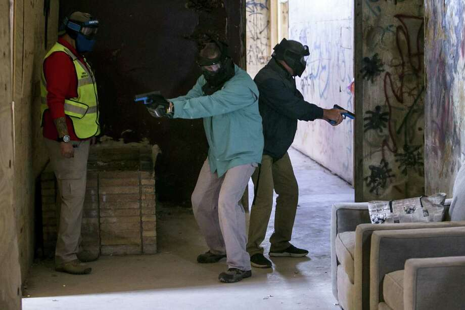 PHOTOS: Arming school employeesTexas a school employees participate in a simulation during school marshal training at at Bexar County Firearms Training Center in San Antonio, Texas.   >>Here's how Twitter reacted to Trump's proposal to arm teachers  Photo: Josie Norris, MBO / Associated Press / ' San Antonio Express-News