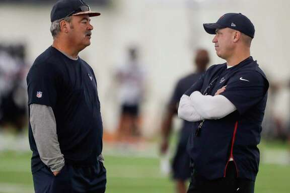 Cal McNair, Houston Texans chief operating officer, left, talks to head coach Bill O'Brien during training camp at the Methodist Training Center on Thursday, Aug. 23, 2018, in Houston.