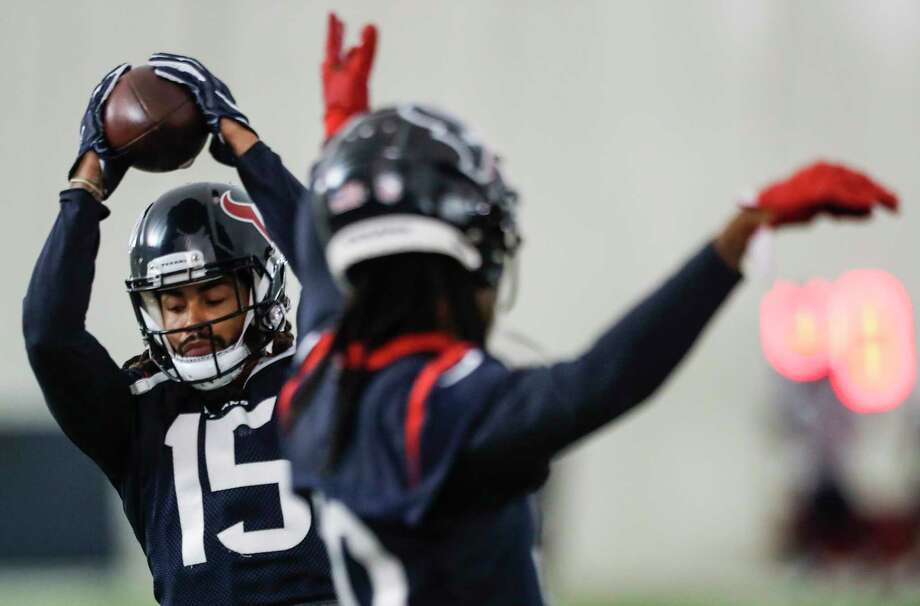 Houston Texans wide receiver Will Fuller (15) makes a catch during a drill at training camp at the Methodist Training Center on Thursday, Aug. 23, 2018, in Houston. Photo: Brett Coomer, Staff Photographer / © 2018 Houston Chronicle