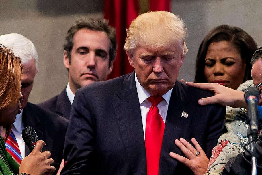 FILE — Michael Cohen, behind Donald Trump on the left, at a campaign stop at the New Spirit Revival Center in Cleveland, Sept. 21, 2016. Coordinating with Michael Cohen, a tabloid giant turned its tip line into a trip wire for negative stories that could hurt the Trump campaign, prosecutors said.  (Eric Thayer/The New York Times) Photo: ERIC THAYER, NYT