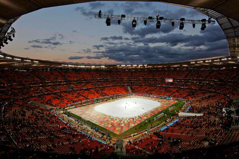 Workers prepare the pitch for the closing ceremony prior to the World Cup final soccer match between the Netherlands and Spain at Soccer City in Johannesburg, South Africa, Sunday, July 11, 2010.  (AP Photo/Themba Hadebe) Photo: Themba Hadebe / AP