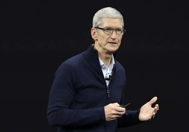 FILE- In this Sept. 12, 2017, file photo, Apple CEO Tim Cook, shows new Apple Watch Series 3 product at the Steve Jobs Theater on the new Apple campus in Cupertino, Calif.  Apple has become the world�s first company to be valued at $1 trillion, the financial fruit of tasteful technology that has redefined society since two mavericks named Steve started the company 42 years ago. (AP Photo/Marcio Jose Sanchez, File)